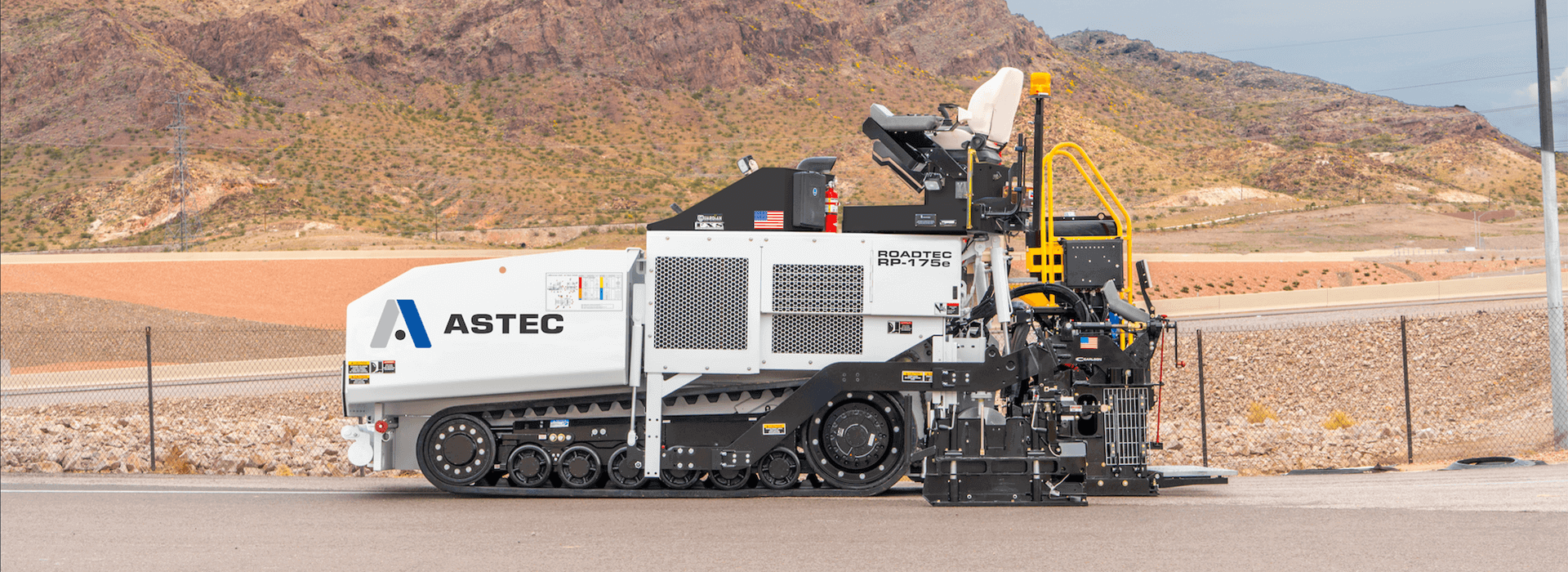Roadtec RP-175 highway class asphalt paver on road with mountains in the background