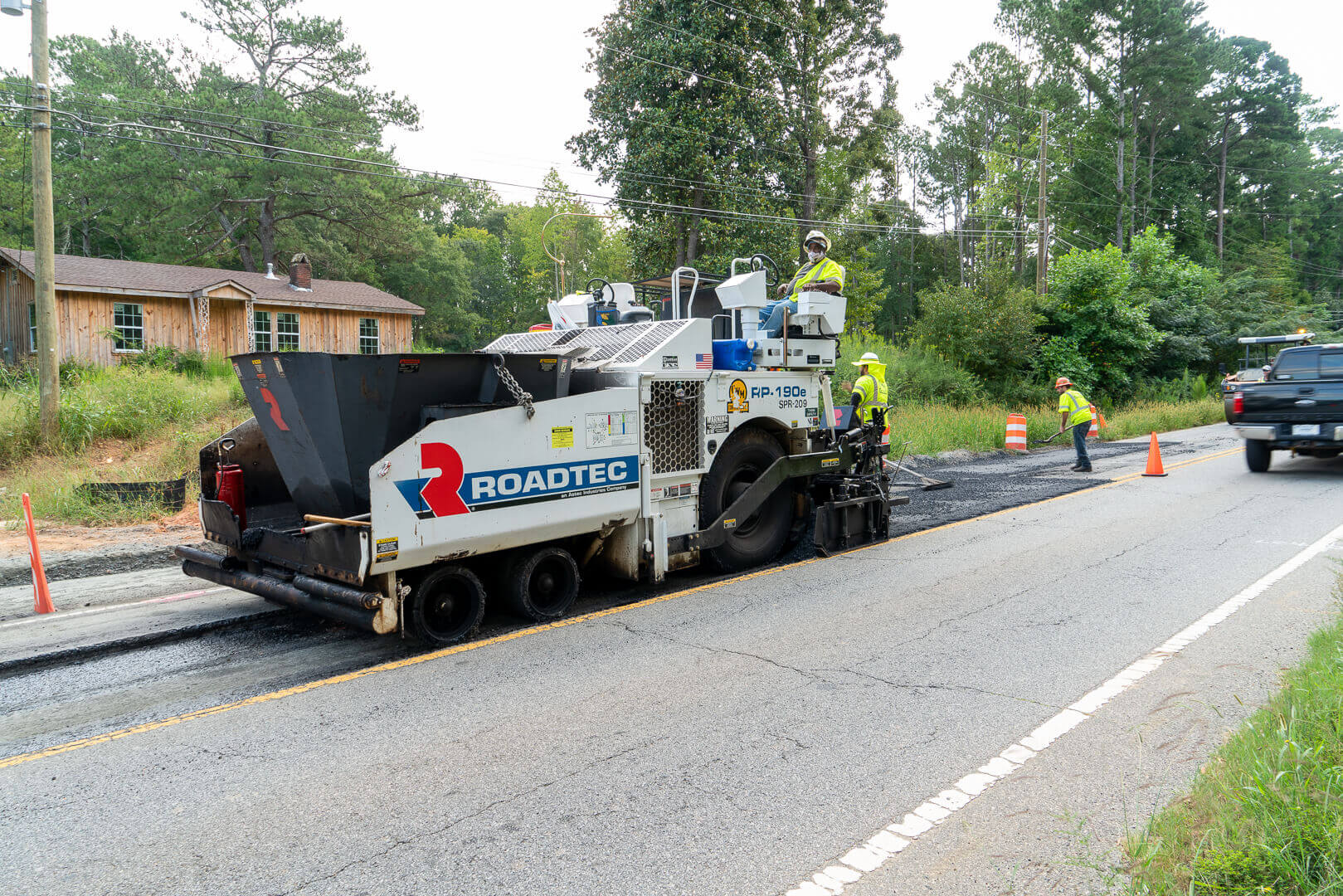 Roadtec RP-190 Highway Class Asphalt Paver paving with hopper insert