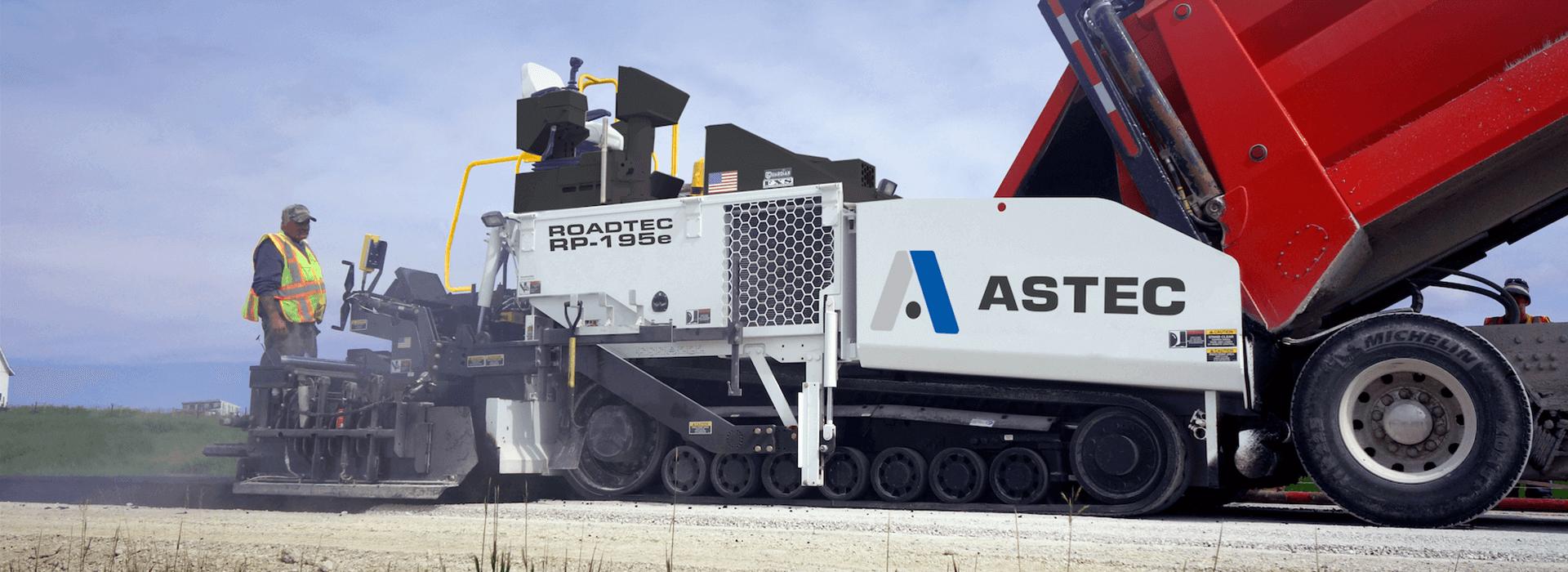 Roadtec RP-195 highway class asphalt paver paving with a dump truck