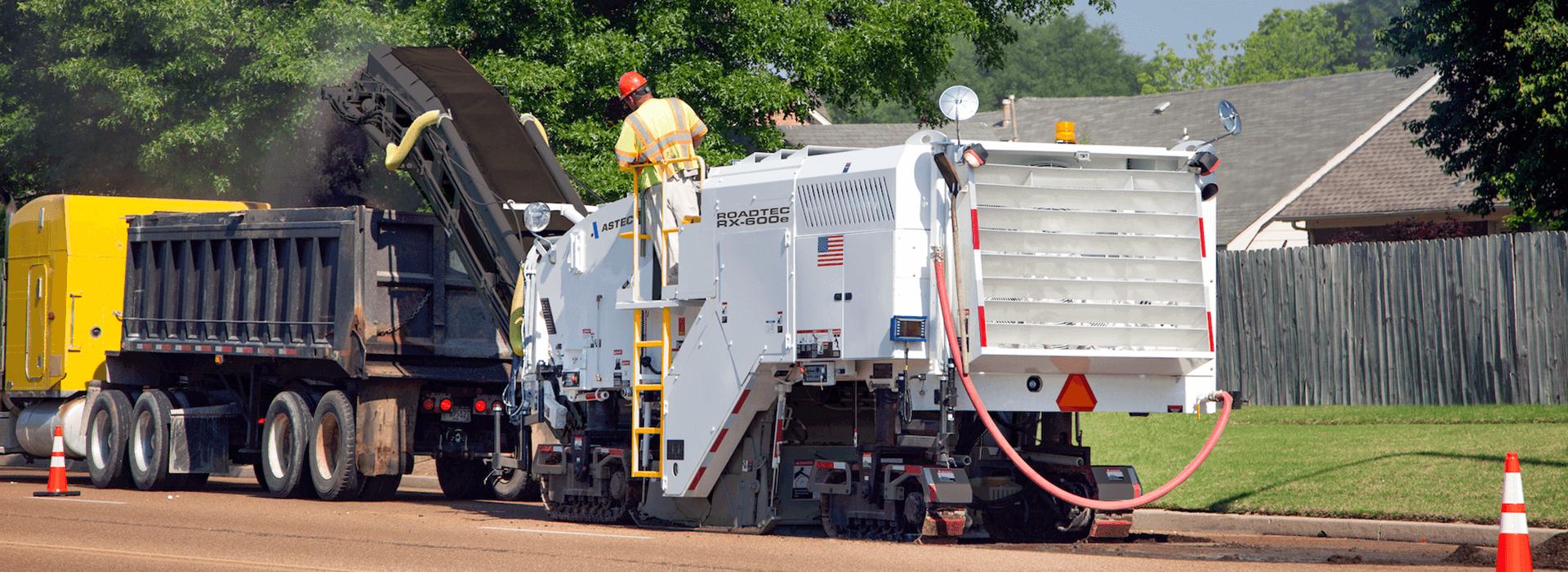 Roadtec RX-600 Cold Planer milling asphalt of road surface into a dump truck