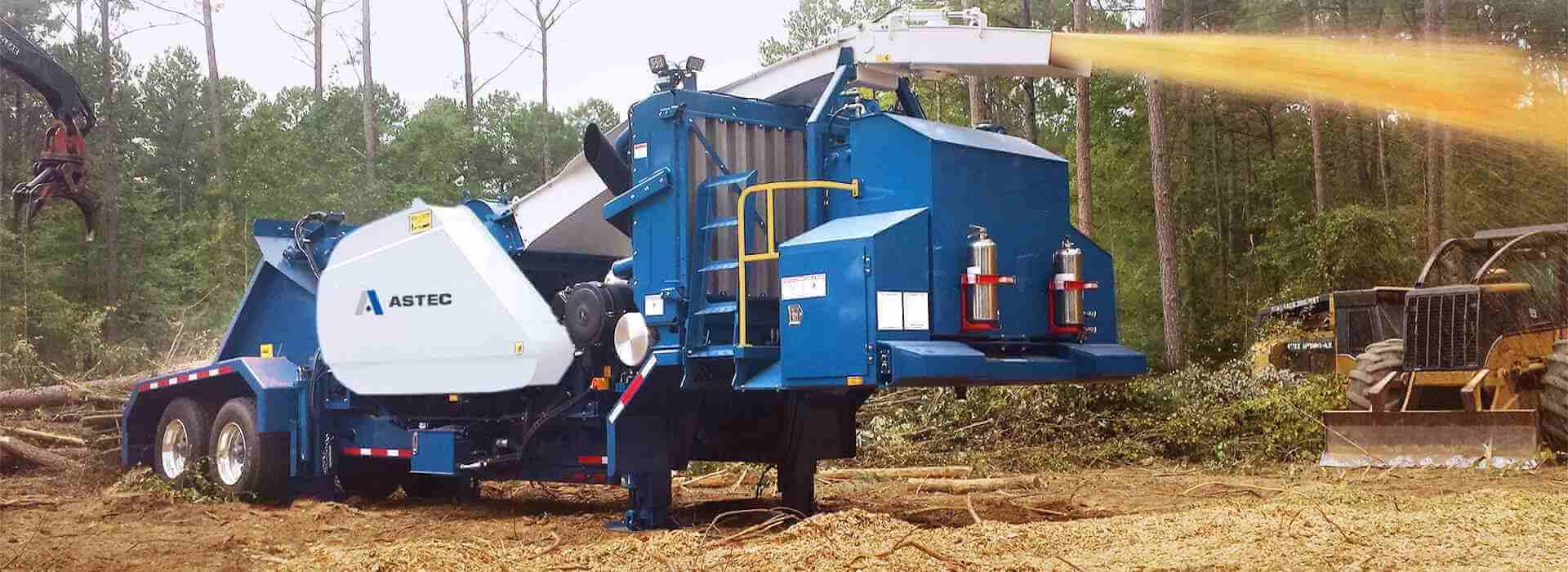 Peterson 4300B Drum Chipper making biomass chips