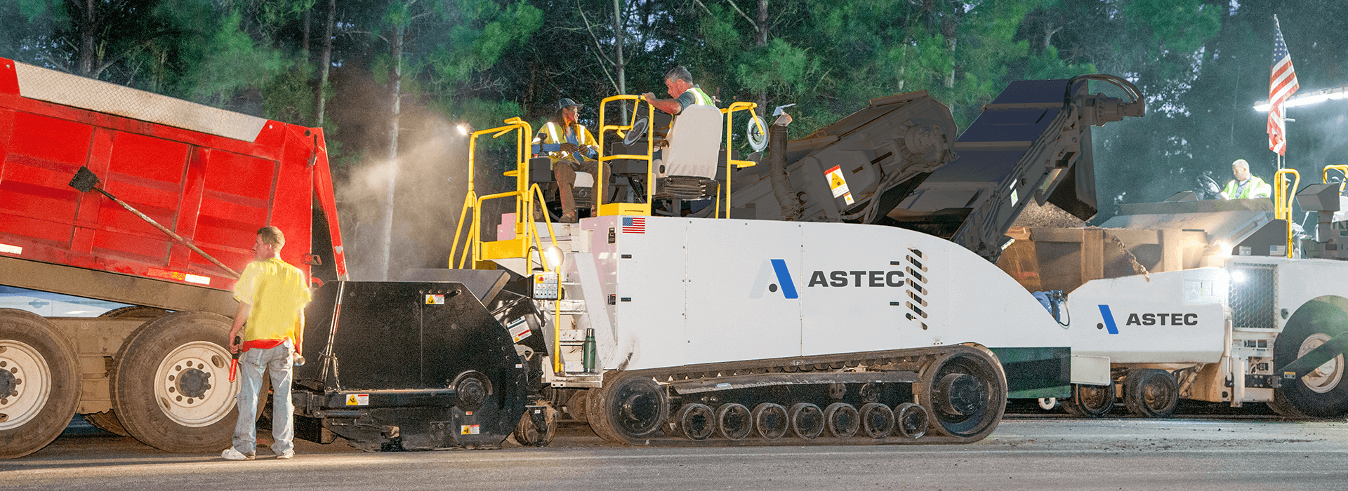 A Roadtec MTV-1105 material transfer vehicle working with a roadtec RP-190 paver
