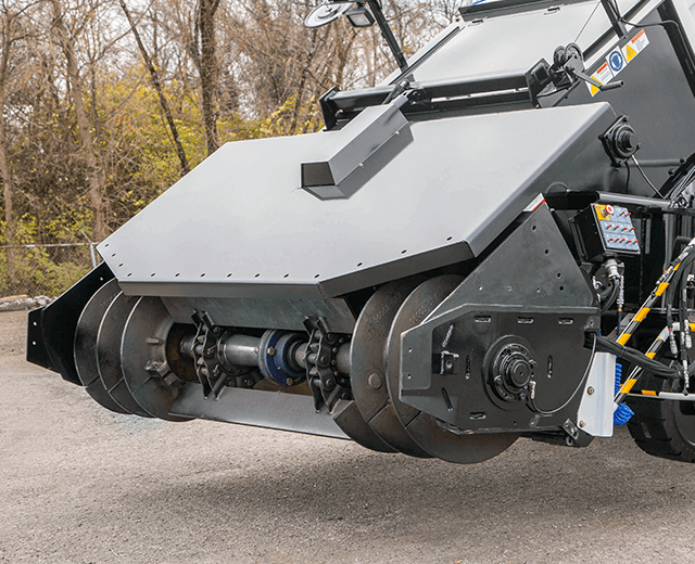 The Roadtec SB-3000 Shuttle Buggy Material Transfer Vehicle showing the front hopper removed with the quick change system in place