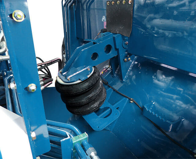 A close-up view of a Peterson Horizontal Grinder's Impact Release System airbag from a 4710D
