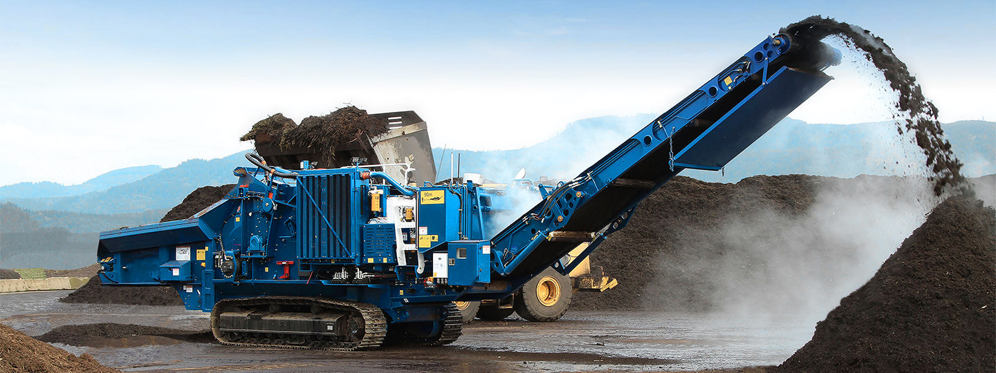 Compost production with horizontal grinder using wheel loader