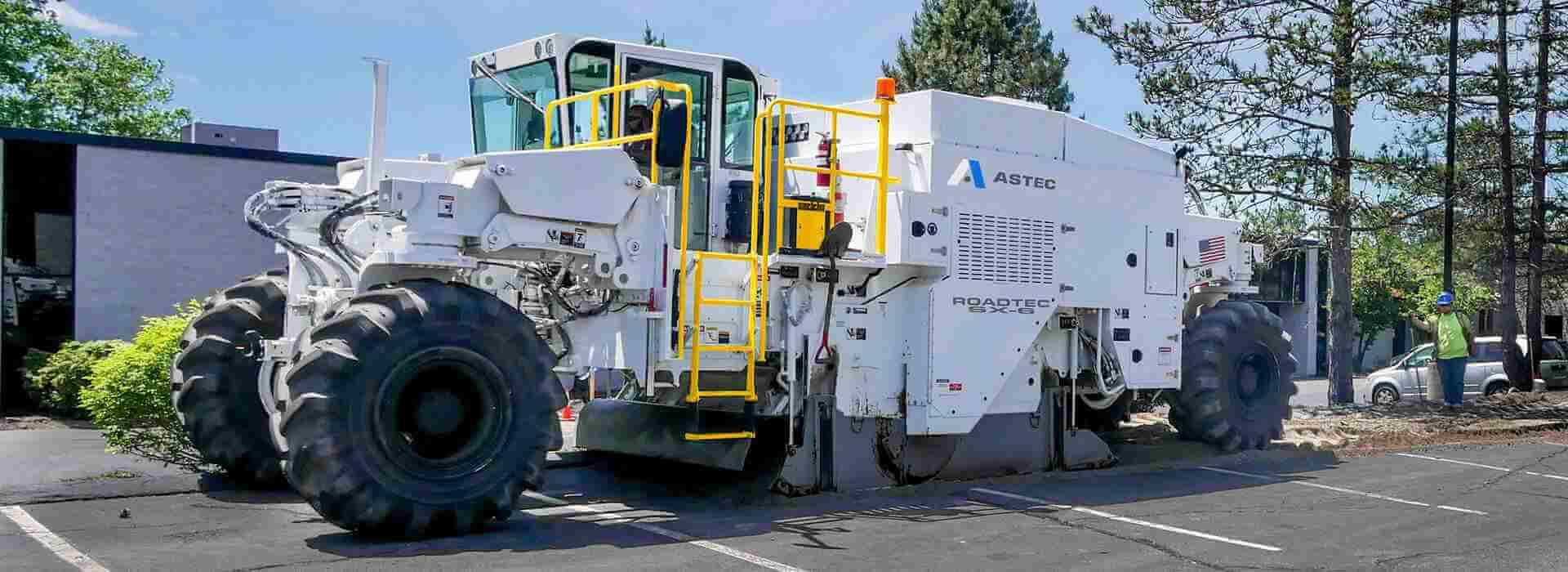Roadtec SX-6 Soil Stabilizer/Reclaimer reclaiming an asphalt surface