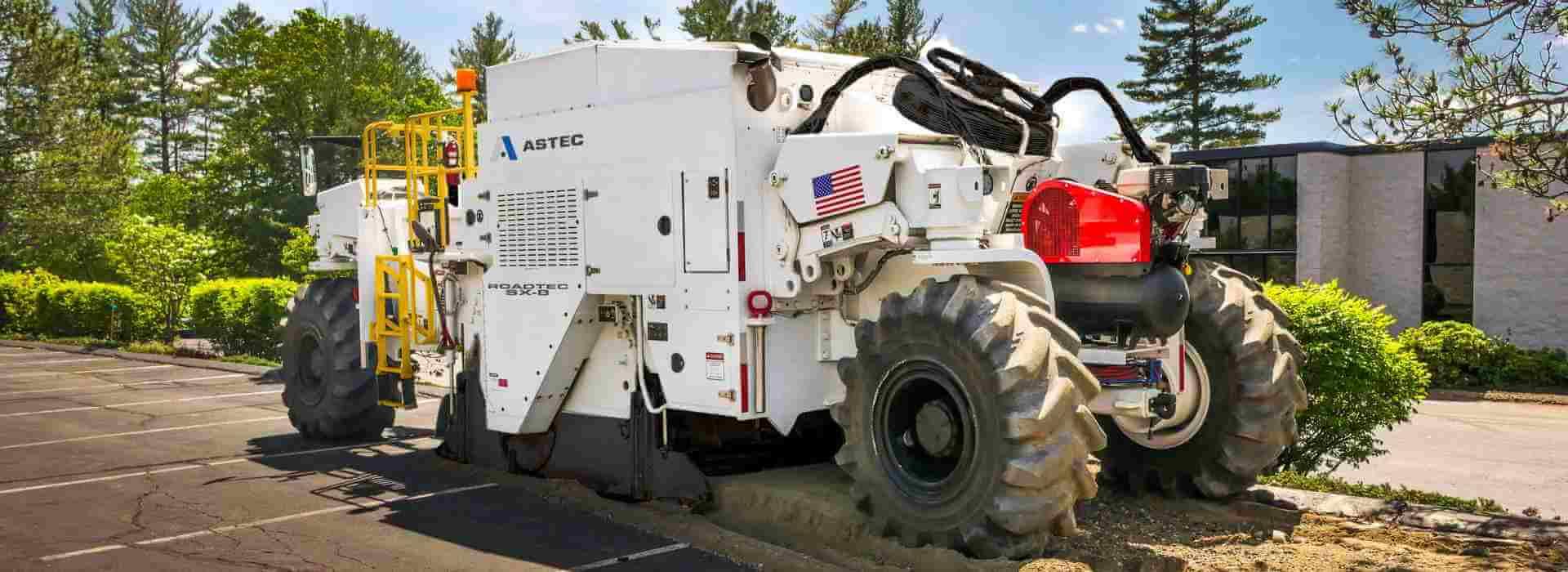 Roadtec SX-8 Soil Stabilizer/Reclaimer reclaiming an asphalt surface